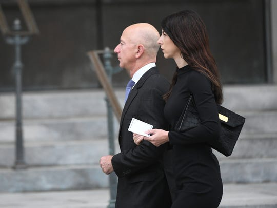 Jeff Bezos and his wife MacKenzie Bezos approached the National Cathedral in Washington for a memorial service for John McCain on Sept. 1, 2018.