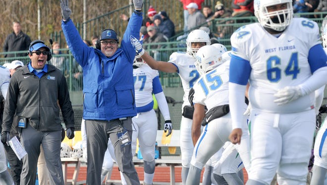 UWF football coach Pete Shinnick celebrates on the sideline at the end of Saturday's 27-17 win over Indiana (Pa.) in the NCAA Division II semifinals in Indiana, Pennsylvania.
