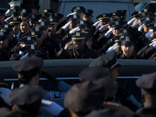 nypd officers shot salute