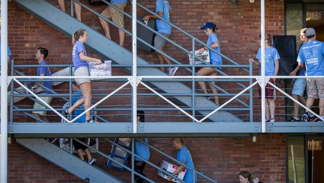 Students help move other students' belongings at Crawford Hall at Drake University on Aug. 23, 2017.