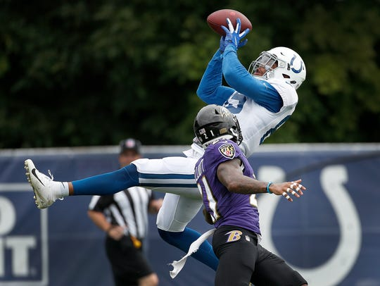Colts tight end Eric Ebron pulled in a catch over Ravens defensive back DeShon Elliott during their joint practice Friday at Grand Park in Westfield.