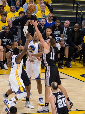 Golden State Warriors forward David West (3) passes the ball against San Antonio Spurs forward Kawhi Leonard (2) and forward David Lee (10) with Golden State Warriors forward Draymond Green (23) during the second quarter in game one of the Western conference finals of the 2017 NBA Playoffs at Oracle Arena on May 14.