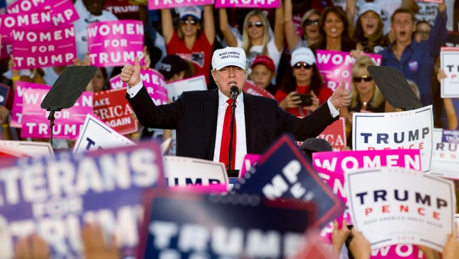 Republican presidential nominee Donald Trump gives two thumbs up near the conclusion of his speech during his rally at the Collier County Fairgrounds on Sunday, Oct. 23, 2016, in Golden Gate Estates.