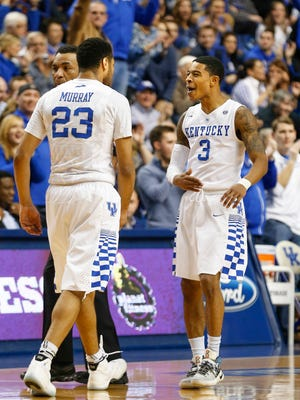 Kentucky's Tyler Ulis (#3) celebrates with teammate Jamal Murray after knocking down a three. Jan. 27, 2016