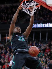 Whitefish Bay Dominican's Diamond Stone dunks against Eau Claire Regis during the first half of their Division 4 semifinal game.