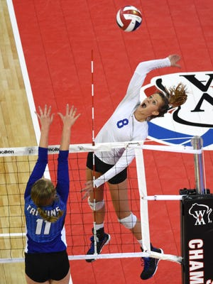 Catholic Memorial's Lexi Alden spikes over Notre Dame Academy's Corinne Meglic during the first set of the Division 2 WIAA State Girls Volleyball championship match.