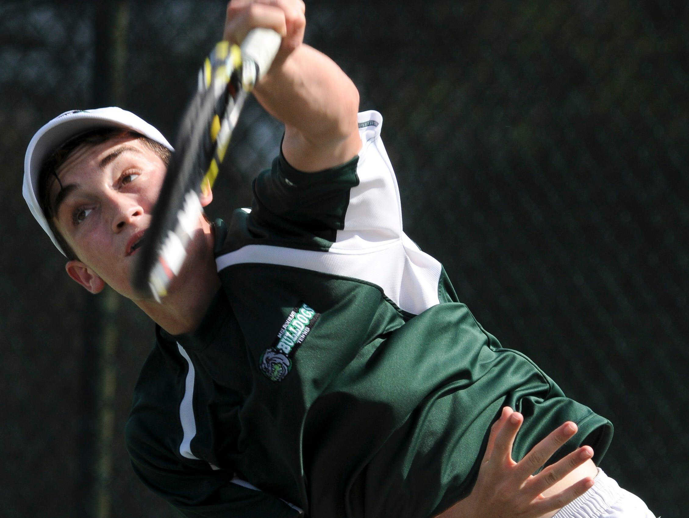 Greg Durham of Melbourne serves the ball during a recent match against Matheus Olivera of Lake Nona.