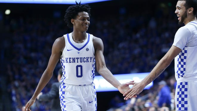 Kentucky Wildcats guard De'Aaron Fox high fives guard Mychal Mulder during the second half against the Auburn Tigers at Rupp Arena in Lexington, Ky. on Saturday, January 14, 2017.