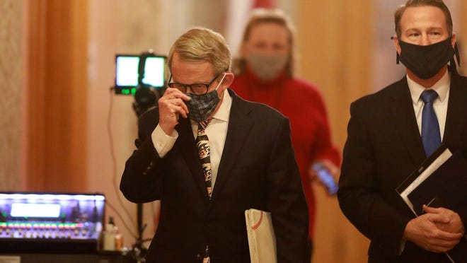 Ohio Gov. Mike DeWine (left) and Lt. Gov. Jon Husted wear their masks while walking into the daily coronavirus news conference on Friday, April 17, 2020 at the Ohio Statehouse in Columbus, Ohio.