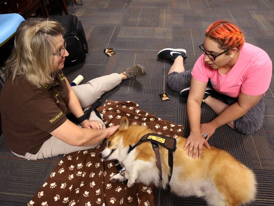Priscilla Babbitt (left) with Paws Up, Inc. talks with