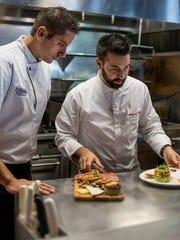 Chefs Fabrice Deletrain, left, and Ben Voisin lead the kitchen at Fathoms in Cape Coral.
