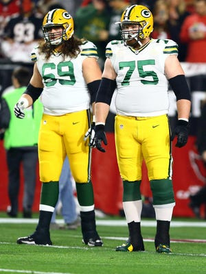 The Packers could look to the draft for help for tackles David Bakhtiari (left) and Bryan Bulaga.