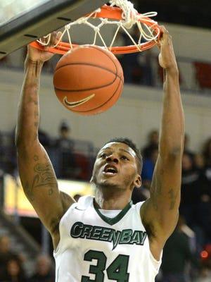 University of Wisconsin-Green Bay's Alfonzo McKinnie slam-dunks the ball against Georgia State at the Resch Center, Saturday, December 27, 2014. H. Marc Larson/Press-Gazette Media/@HMarcLarson