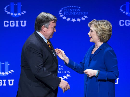 Former U.S. Secretary of State Hillary Clinton welcomes Arizona State University President Michael Crow to the opening plenary session of the Clinton Global Initiative University in 2014. The university paid the Clinton Foundation $500,000 to host the event.