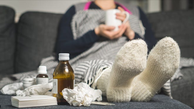 Generic image of person suffering from flu.