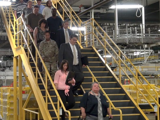 Prospective employees get a tour of the Robbinsville