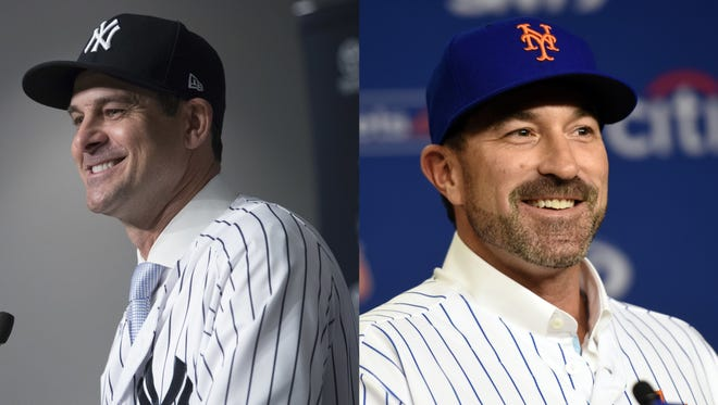 Yankees manager Aaron Boone (left) and Mets manager Mickey Callaway (right).