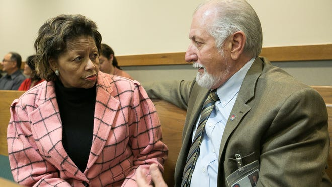 Doña Ana County manager Julia Brown and Doña Ana County Commissioner Wayne Hancock speak together before the start of a court hearing in the restraining-order lawsuit between Doña Ana County Sheriff Enrique Vigil and County Commission at 3rd Judicial District Court on Tuesday.