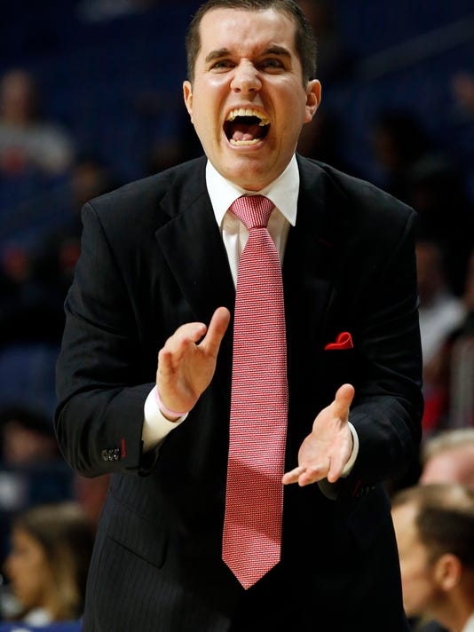 Mississippi head coach Matt Insell encourages his players in the first half of an NCAA college basketball game against South Carolina in Oxford, Miss., Thursday, Feb. 25, 2016. (AP Photo/Rogelio V. Solis)
