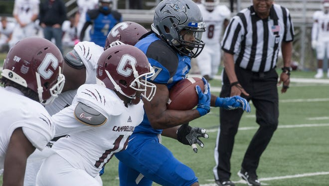 Faulkner running back Joe Jones tries to escape from a defender. The Faulkner Eagles took a tough 59-50 loss against Campbellsville University at home on Saturday, Oct. 3, 2015.