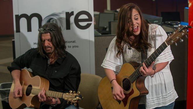 Britt Johnson, right, sings some of her original songs, accompanied by guitarist Kurt McKinney on Monday, May 2, 2016, in the Advertiser newsroom for this week's edition of Montgomery Advertiser LIVE!