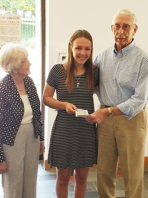 Maddison Stark, center, accepts the first Roger and Joyce Tuttle Scholarship from Joyce, left, and Roger Tuttle, recently at the First United Methodist Church in Pontiac.