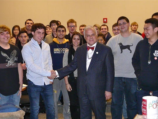 Moorestown's Frank Giordano (center) is shown with a group of entrepreneur students at Drexel University. Giordano, a longtime business owner, helped create a scholarship for business students at Rutgers University-Camden, his alma mater. On March 25, he will receive the Legacy Award from the Legacy Foundation.