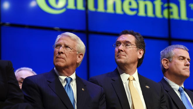 U.S. Sen. Roger Wicker, from left, U.S. Rep. Gregg Harper, Speaker of the Mississippi House Philip Gunn, and U.S. Rep. Bennie Thompson, listen as Gov. Phil Bryant makes remarks during an event at Clinton High School on Monday to formally announce Continental Tires' new manufacturing plant to be located just west of Clinton, in Hinds County.