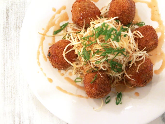 Smoked mullet croquetas with shoestring potatoes and