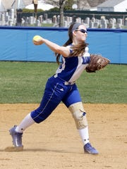 Jill Murray throws from third base for an out against