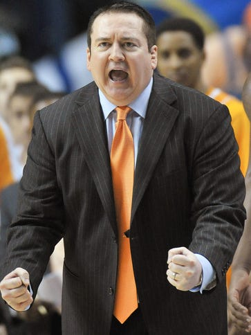 Donnie Tyndall shouts instructions to his team during