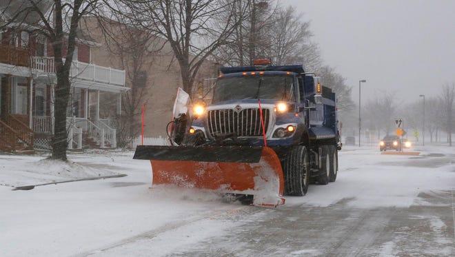 A City of Sheboygan snowplow clears snow on Broughton Drive Monday, Dec. 28, 2015 in Sheboygan.