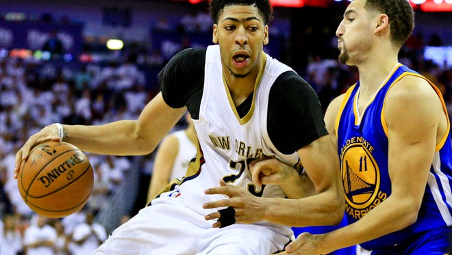 Apr 25, 2015; New Orleans, LA, USA; New Orleans Pelicans forward Anthony Davis (23) is defended by Golden State Warriors guard Klay Thompson (11) during the second half in game four of the first round of the NBA Playoffs at the Smoothie King Center. The Warriors defeated the Pelicans 109-98. Mandatory Credit: Derick E. Hingle-USA TODAY Sports ORG XMIT: USATSI-224320 ORIG FILE ID:  20150425_ggw_ah6_192.JPG