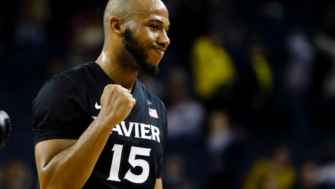 Xavier Musketeers guard Myles Davis (15) celebrates after the game against the Michigan Wolverines at Crisler Center. Xavier won 86-70.
