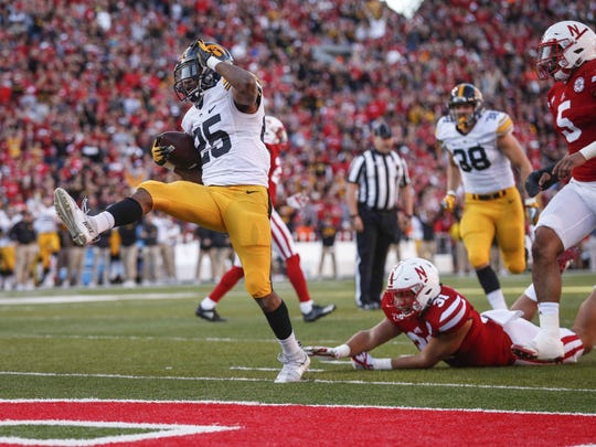 Akrum Wadley topped 1,000 rushing yards and was named third-team all-Big Ten in each of the past two seasons. He's coming off a 159-yard game at Nebraska, pictured.