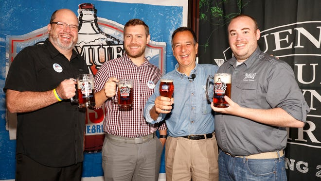 LongShot competition winners Tim Thomssen and Kevin Nanzer, Samuel Adams Founder Jim Koch and Samuel Adams employee and LongShot competition winner Colin Foy.