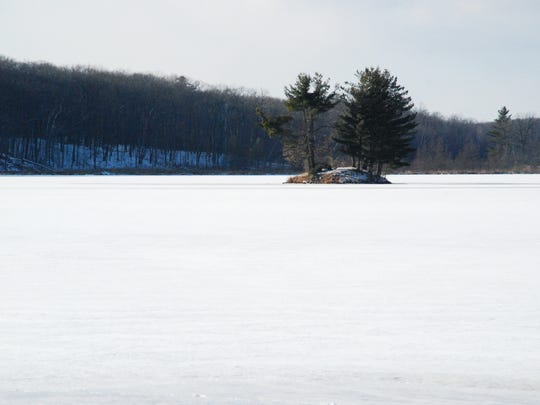 An island stands our among the frozen surface of Straight