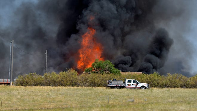 A Black Eagle Volunteer Fire Department truck arrives on the scene of a structure fire off of Vinyard Road last month.  The high risk of fire due to hot, dry conditions prompted Cascade County to implement fire restrictions effective Saturday