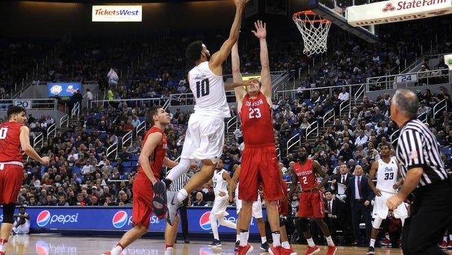Nevada's Caleb Martin shoots over Davidson's Peyton Aldridge during their basketball game at Lawlor Events Center in Reno on Nov. 21, 2017.