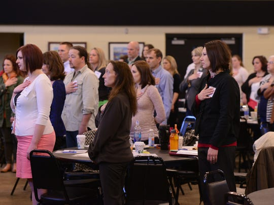 Attendees of the Minnesota Military Mental Health Initiative conference stand for the singing of the national anthem April 15 at Camp Ripley.