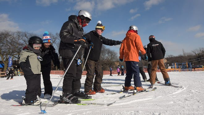Autistic adults and kids get free ski lessons in Lisle, Ill., on Jan. 17, 2016.