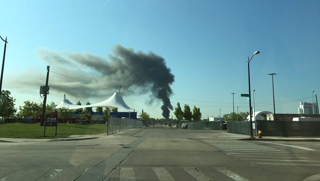 Smoke from a fire in Windsor, Ontario, Canada is visible the morning of May 23, 2016 from across the Detroit River in Detroit.