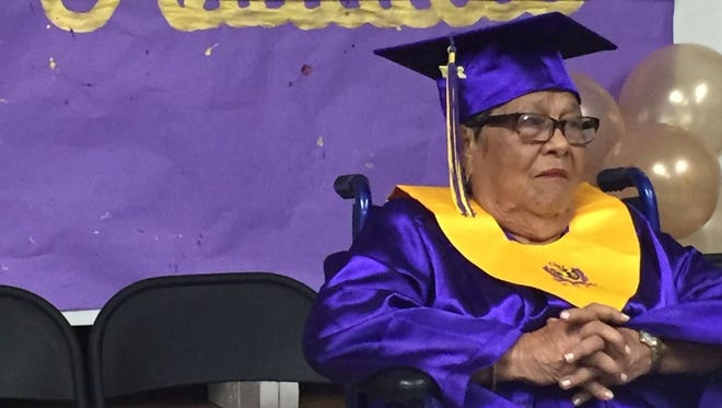World War II survivor Catalina Hernandez Tarusan, 88, Wednesday morning receives an honorary diploma from George Washington High School during a ceremony at the school.