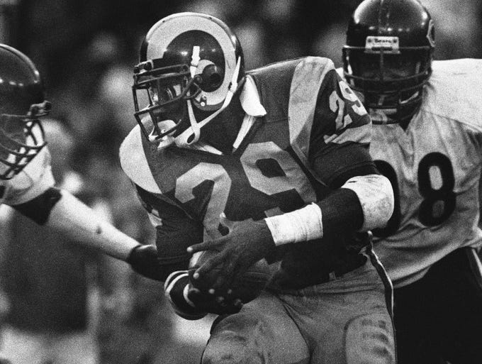 Eric Dickerson, 1984 -- 2,105 yards, 14 TDs: In just