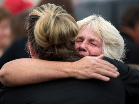 Community members embrace Monday, October 2, 2017, during a gathering in honor of Las Vegas shooting victim Sonny Melton in Big Sandy. The 29-year-old was a native of Big Sandy, Tenn., and attended the concert with his wife, Heather. Heather said her husband saved her life while gunfire was hitting the crowd.