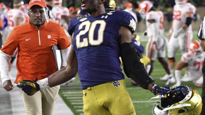 Notre Dame safety Shaun Crawford (20) celebrates after Notre Dame defeated Clemson 47-40 in two overtimes on Saturday in South Bend, Ind.