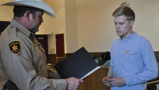 Carlsbad High School senior Will Riley was sworn in as an honorary sheriff's deputy Wednesday, April 25, 2018, at the Fifth Judicial District Courthouse in Carlsbad. Riley was sworn in by Sheriff' Mark Cage.