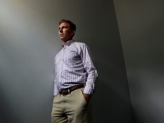 State Rep. Ryan Williams stands for a photo in Cookeville, Tenn., on Aug. 7, 2016. In 2014, the Republican lawmaker introduced a bill to put limits on opioid prescriptions in Tennessee, concerned about pregnant mothers getting hooked on opioids and passing the addiction on to their babies. Williams' mission failed that year, but his bill succeeded the next year.