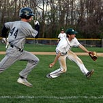 McNicholas pitcher Chris Clark throws out Bishop Brossart's T.J. Moore on a bunt attempt Thursday. The Rockets won the game, 7-1.