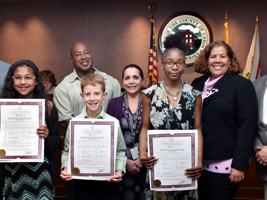 The fifth grade winners of the 2018 Union County Arbor Day Poetry contest are pictured with county freeholders; left to right are Isabella Charles, first place from Evergreen Elementary School in Plainfield, James Parrillo, second place from Winfield School, and Kelis Cureton, third place from School #1in Linden.